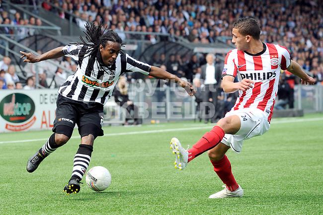 ALMELO - voetbal, Heracles Almelo - PSV, Eredivisie , Polman stadion, seizoen 2010-2011, 17-04-2011   Heracles speler Darl Douglas (l) met PSV speler Zakaria Labyad (r)