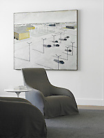 The lines and colour of the linen-covered armchairs echo those in a large abstract painting on the wall behind them