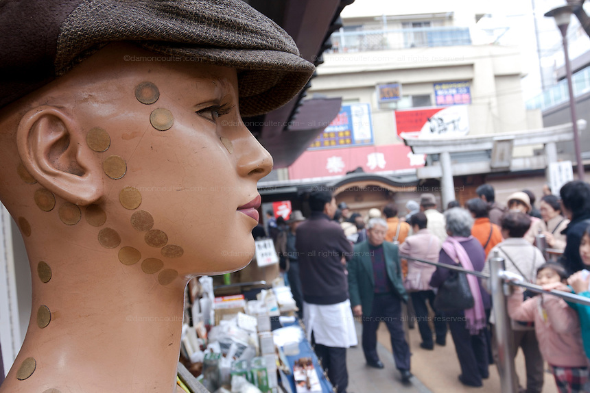 A mannequin with acupuncture stickers on it at Toganji Temple in Sugamo, Tokyo, Japan. Saturday, March 7th 2009. Sugamo is affectionately known as the old lady Harajuku, in reference to the Mecca for youth fashions in the South of Tokyo, and is a popular place for Tokyo's increasingly aged population.