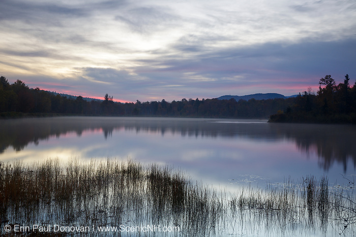 Durand Lake in Randolph, New Hampshire USA at sunrise during the autumn months.