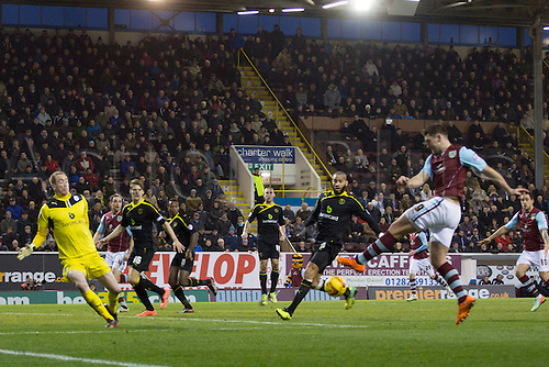 18.01.2014 Burnley, England. Sam Vokes and  Oguchi Onyewu during the Championship game between Burnley and Sheffield Wednesday from Turf Moor.
