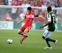 Chicago midfielder Logan Pause (12) plays the ball in front of Portland midfielder Darlington Nagbe (6).  The Portland Timbers defeated the Chicago Fire 1-0 at Toyota Park in Bridgeview, IL on July 16, 2011.
