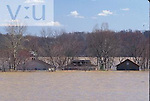 Homes in Utica, Indiana englulged by Ohio River during flood of nineteen ninety seven.