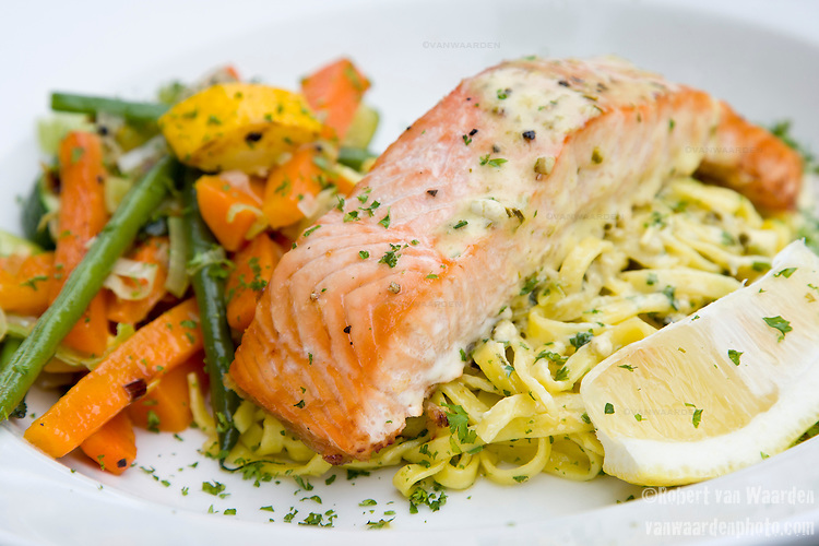 A salmon and noodle dish served at a restaurant in Cavendish, Suffolk, the United Kingdom.