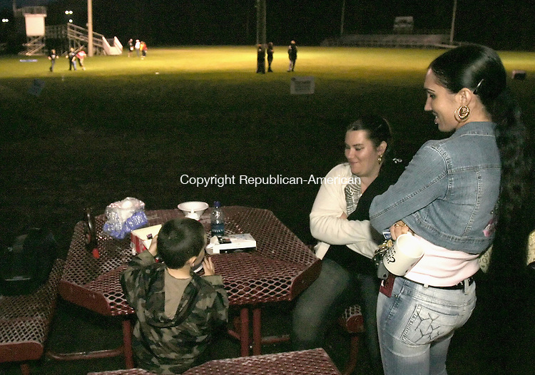 WATERBURY, CT--28 APRIL 2007--042807JS07-Heather Britton of Waterbury, right, talks with her son Isaac, 4, left and her sister Dawn Britton, center, during Saturday's Habitit for Humanity's fundraiser at Municipal Stadium in Waterbury. Supporters were spending the night outside to raise money and awareness to their efforts. Heather Britton will be the first beneficiary of a house by the Greater Waterbury region of Habitat for Humanity.<br /> <br /> Jim Shannon / Republican-American