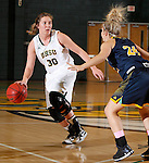FEBRUARY 14, 2015 -- Cassidy Kotelman #30 of Black Hills State dribbles toward Taylor Torres #24 of Colorado Christian during their Rocky Mountain Athletic Conference women's basketball game Saturday at the Donald E. Young Center in Spearfish, S.D.  (Photo by Dick Carlson/Inertia)