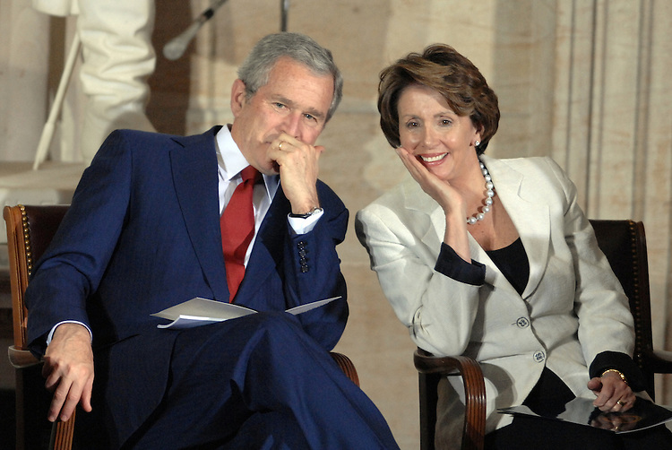 President George W. Bush and Speaker of the House Nancy Pelosi, D-Calif., talk in the Capitol Rotunda before a Congressional Gold Medal ceremony honoring the Tuskegee Airmen.  The group honored were black aviators who fought in WWII.