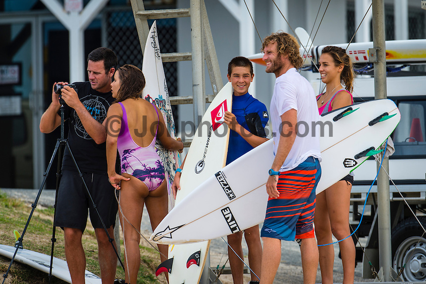 Coolangatta, Queensland, Australia. (Wednesday, January 29, 2014)  Australian team coach Andy King (AUS) with Cody Klein (AUS), Dextar Muskins (AUS), Jay Bottle Thompson (AUS) and Sally Fitzgibbons (AUS). –  The swell was from the south east this morning in the 5'-6' range. The wind was  from the South East as well and with a Cyclone Dane forming in the Coral Sea the surf improved throughout the day.  Photo: joliphotos.com