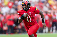 Landover, MD - September 1, 2018: Maryland Terrapins quarterback Kasim Hill (11) runs the football during game between Maryland and No. 23 ranked Texas at FedEx Field in Landover, MD. The Terrapins upset the Longhorns in back to back season openers with a 34-29 win. (Photo by Phillip Peters/Media Images International)