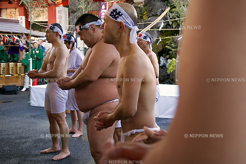 "January 10, 2015, Tokyo, Japan : Participants warm themselves up after taking a ""purification"" dip ice cold water during the Annual New Year ice bath ceremony at Kanda Myojin Shinto. A group of 38 brave men a women wearing  only shorts or loincloths pour cold water over themselves in a traditional ""soul-purification"" ceremony to test their endurance, they believe would purify their souls and bring them good luck.  (Photo by Rodrigo Reyes Marin/AFLO)"