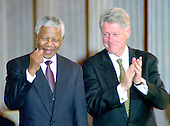 Washington, DC - September 23, 1998 -- President Nelson Mandela of South Africa and United States President Bill Clinton acknowledge the audience after the former's acceptance of the Congressional Gold Medal in The United States Capitol Rotunda on Wednesday, September 23, 1998...Credit: Ron Sachs / CNP