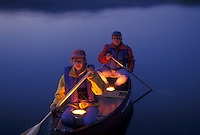 canoeing, canoe, Vermont, VT, Candles reflect on a mother and daughter in a red canoe in the evening on Island Pond.