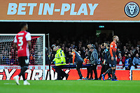 Martin Olsson of Swansea City is stretchered off during the Sky Bet Championship match between Brentford and Swansea City at Griffin Park, Brentford, England, UK. Saturday 08 December 2018