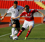 Kaan Ayhan (L) of Germany battles for the ball with Lasse Christensen of Denmark during the UEFA U17 Championships Semi Final match between Denmark and Germany on May 12, 2011 in Novi Sad, Serbia. (Photo by Srdjan Stevanovic/Starsportphoto.com)