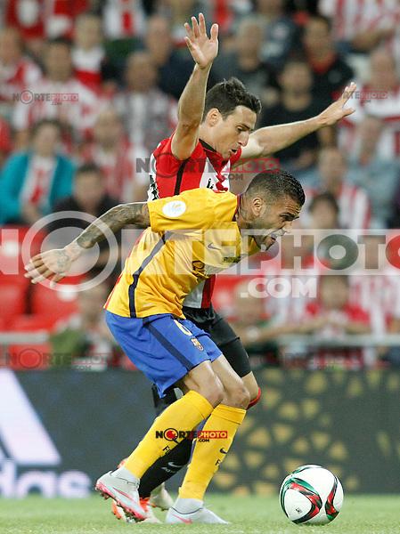 Athletic de Bilbao's Aritz Aduriz (l) and FC Barcelona's Daniel Alves during Supercup of Spain 1st match.August 14,2015. (ALTERPHOTOS/Acero)
