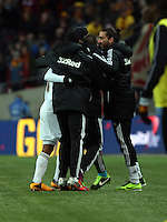 Pictured: Jonathan de Guzman of Swansea celebrating his goal with a penalty kick with members of the coaching staff. Sunday 24 February 2013<br /> Re: Capital One Cup football final, Swansea v Bradford at the Wembley Stadium in London.