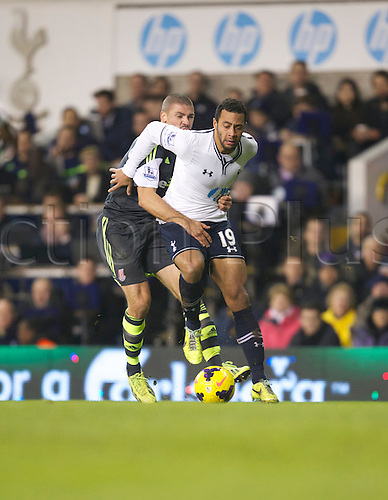 29.12.2013. White Hart Lane, London England. Jonathan Walters of Stoke City gets to grips with Mousa Dembele of Tottenham Hotspur during the Premiership match between Tottenham Hotspur and Stoke City.