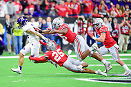 Indianapolis, IN - DEC 1, 2018: Northwestern Wildcats running back Isaiah Bowser (25) breaks free of Ohio State Buckeyes safety Brendon White (25) and a few other Buckeyes on his way to a first down during the Big Ten Championship game between Northwestern and Ohio State at Lucas Oil Stadium in Indianapolis, IN. (Photo by Phillip Peters/Media Images International)