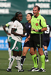 18 July 2009: Referee Ted Unkel (right) talks to Saint Louis' Eniola Aluka (ENG) (left). The Washington Freedom defeated Saint Louis Athletica 1-0 at the RFK Stadium in Washington, DC in a regular season Women's Professional Soccer game.