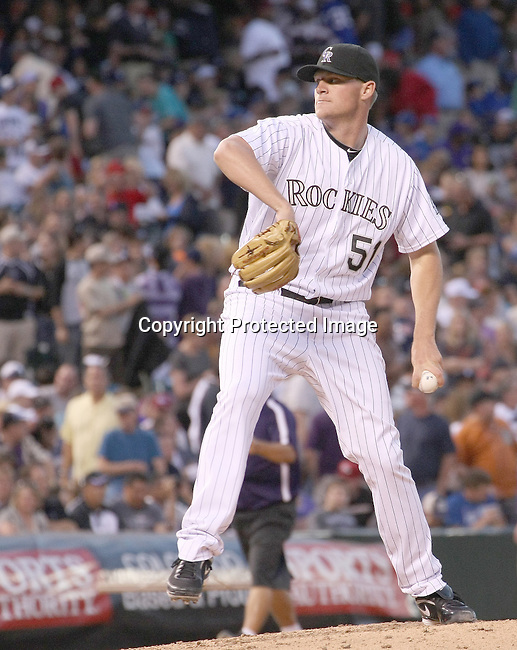 Colorado Rockies relief pitcher Matt Reynolds (51) warms up during a game against the Detroit Tigers. The Rockies defeated the Tigers 5-4 on June 19, 2011 at Coors Field in Denver, Colorado. (AP Photo/Margaret Bowles)