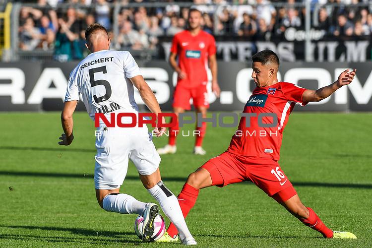 10.08.2019, Donaustadion, Ulm, GER, DFB Pokal, SSV Ulm 1846 Fussball vs 1. FC Heidenheim, <br /> DFL REGULATIONS PROHIBIT ANY USE OF PHOTOGRAPHS AS IMAGE SEQUENCES AND/OR QUASI-VIDEO, <br /> im Bild Zweikampf, Johannes Reichert (Ulm, #5), Kevin Sessa (Heidenheim, #16)<br /> <br /> Foto © nordphoto / Hafner