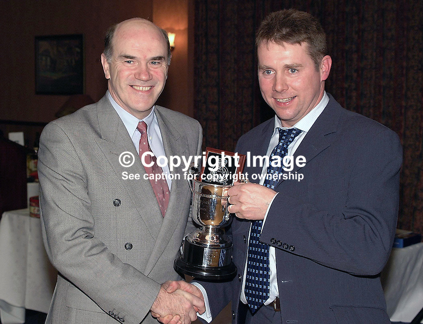 Sir Ronnie Flanagan, Chief Constable, Royal Ulster Constabulary, presenting trophy to Constable Josh Semple, Omagh, at RUC Motor Club Social Function. Ref: 200202024905..Copyright Image from Victor Patterson, 54 Dorchester Park, Belfast, UK, BT9 6RJ..Tel: +44 28 9066 1296.Mob: +44 7802 353836.Voicemail +44 20 8816 7153.Skype: victorpattersonbelfast.Email: victorpatterson@mac.com.Email: victorpatterson@ireland.com (back-up)..IMPORTANT: If you wish to use this image or any other of my images please go to www.victorpatterson.com and click on the Terms & Conditions. Then contact me by email or phone with the reference number(s) of the image(s) concerned.