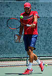 SURPRISE, AZ - MAY 12: Arnold Kokulewski of the Columbus State Cougars returns a ball against Flavio Matteoli of the Barry Buccaneers during the Division II Men's Tennis Championship held at the Surprise Tennis & Racquet Club on May 12, 2018 in Surprise, Arizona. (Photo by Jack Dempsey/NCAA Photos via Getty Images)