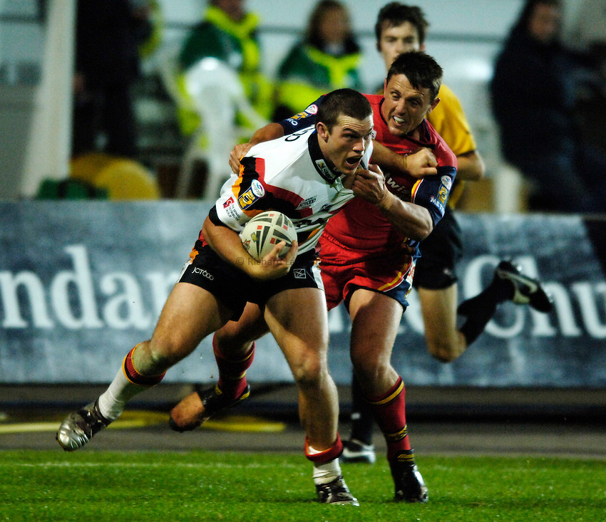 Photo: Jed Wee..Bradford Bulls v London Broncos. Engage Super League. 23/09/2005...Ben Harris (L) with Lee Hopkins.