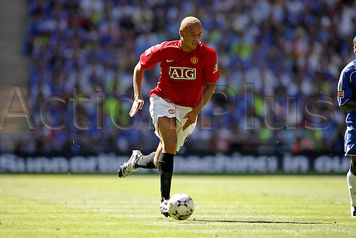 5 August 2007: Manchester United defender Wes Brown runs with the ball during the FA Community Shield played between Chelsea and Man Utd at Wembley Stadium. The game finished 1-1, with Man Utd winning the penalty shoot-out 3-0. Photo: Glyn Kirk/Actionplus....070805 football soccer player