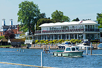 Henley on Thames. United Kingdom.   View of the Phyllis Court Club  A small working boat [Willow Brook] moving down the Regatta course   Thursday  17/05/2018<br /> <br /> [Mandatory Credit: Peter SPURRIER:Intersport Images]<br /> <br /> LEICA CAMERA AG  LEICA Q (Typ 116)  f5  1/1000sec  35mm  42.5MB