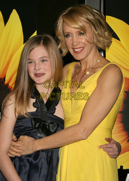 "ELLE FANNING & FELICITY HUFFMAN .""Phoebe In Wonderland"" Los Angeles Screening held at the Writers Guild Theater, Beverly Hills, California, USA, 1st March 2009..half length blue black silk satin dress bow hugging embracing  arms arms around yellow .CAP/ADM/MJ.©Michael Jade/Admedia/Capital Pictures"