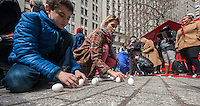 Urban Shaman Donna Henes'  39th Annual Eggs on End:  Vernal Equinox Celebration in Bowling Green Park in New York welcoming in the first day of spring on Thursday, March 20, 2014.  At the precise moment of the Spring Equinox, this year at 12:57 PM, a raw egg can be stood on its end bringing good luck for the rest of the year and dozens of participants were glad to see winter go at the ceremony. Henes has been organizing this event for 39 years.   (© Richard B. Levine)