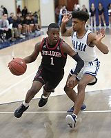 NWA Democrat-Gazette/ANDY SHUPE<br /> Springdale's Jajuan Boyd (left) drives past Har-Ber's Micah Seawood Friday, Feb. 8, 2019, during the first half of play in Wildcat Arena in Springdale. Visit nwadg.com/photos to see more photographs from the games.
