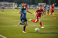 Kansas City, Mo. - Saturday April 23, 2016: Portland Thorns FC defender Meghan Klingenberg (25) chases FC Kansas City midfielder Heather O'Reilly (9) during a match at Swope Soccer Village. The match ended in a 1-1 draw.