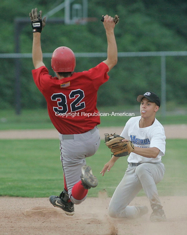 WATERTOWN, CT -22 July 2005- 072205BZ03- Wolcott #32, Craig Hassinger tries unsuccessfully to get into second as Bridgeport #9, Brett Shulick waits to make the tag during the championship round of the Mickey Mantle Tournament Friday evening.<br /> Jamison C. Bazinet photo