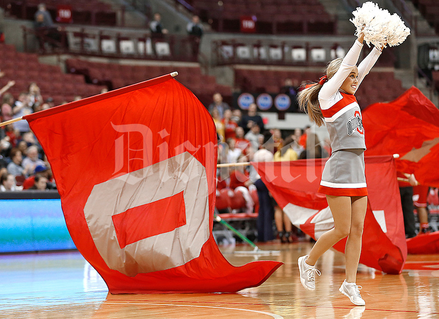 1004707028<br /><br />The Ohio State cheerleaders entertain the crowd during a timeout against Wisconsin at Value City Arena on February 4, 2016.  (Chris Russell/Dispatch Photo)