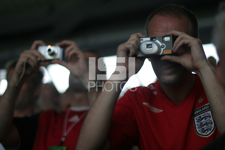 Soccer fans in the stands at Hannover FIFA World Cup stadium get their camera's ready to take a photograph of Spain's penalty-kick against France during France and Spain's  second round FIFA World Cup match in Hannover, Germany  on Tuesday, June 27th 2006.  Spain scored the goal but France defeated Spain 3-1.