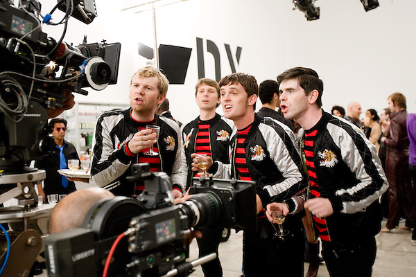 """July 29, 2005. New York , NY..(left to right)  Bob Hardy, Alex Kapranos, Nick McCarthy and Paul Thomson head for the cameras. Behind the scenes with Franz Ferdinand during the  filming of the music video """" Do You Want To"""" in  Manhattan."""