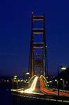 Golden Gate Bridge at twilight with car light streaks across bridge with street lights, San Francisco, California USA The Golden Gate connects San Francisco penninsula and Marin penninsula and is nearly two miles long,  San Francisco, California USA