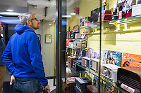 "Ed Tumavicus (blue hoodie, glasses), of Portland, Maine, and Peter Amann, of Scarborough, Maine, (not pictured) look at vintage radios and music memorabilia on display in a hallway off the lobby of The Verb Hotel in the Fenway neighborhood of Boston, Massachusetts, USA, on Friday, Dec. 4, 2015. The hotel is considered a ""boutique hotel"" and has collections on display throughout the premises of music memorabilia from the Boston area. Tumavicus and Amann were staying in the hotel for the weekend while they attended a conference in Boston. The pair reminisced about old Boston-area DJs and the radios they used to have while looking at the hotel's collection."