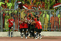 Egypt's Afroto gets a celebratory hug from teammates after making the first goal of the FIFA Under 20 World Cup Group A Match against Trinidad & Tobago at the Egyptian Army Stadium on September 24, 2009 in Alexandria, Egypt.