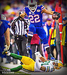14 December 2014: Buffalo Bills running back Fred Jackson jumps over Green Bay Packers free safety Ha Ha Clinton-Dix after taking a screen pass for a 20-yard gain in the fourth quarter at Ralph Wilson Stadium in Orchard Park, NY. The Bills defeated the Packers 21-13, snapping the Packers' 5-game winning streak and keeping the Bills' 2014 playoff hopes alive. Ed Wolfstein Photo. Original shot Nikon D4 RAW (NEF)