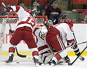 Colin Moore (Harvard - 12), Raphael Girard (Harvard - 30), Kevin Goumas (UNH - 27), Danny Fick (Harvard - 7) - The Harvard University Crimson defeated the University of New Hampshire Wildcats 7-6 on Tuesday, November 22, 2011, at Bright Hockey Center in Cambridge, Massachusetts.