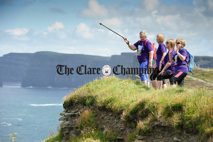 Margaret Maher, Eileen O Doherty, Mary Barry and Sharon King and take in the views during the Weightwatchers/Clare Champion Liscannor to Cliffs of Moher coastal walk. Photograph by John Kelly.