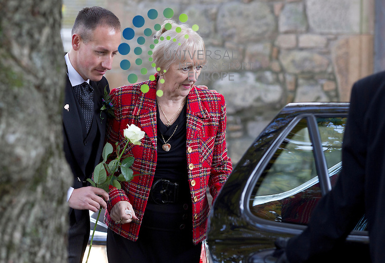 Lil Alexander the wife of Jack Alexander - The funeral of Scottish musician Jack Alexander of The Alexander Brothers is to be held.<br /> Jack and his brother Tom toured the world during a career spanning more than 50 years and were awarded MBEs for services to entertainment.<br /> Mr Alexander, who was 77, was said to have died peacefully with his family around him at Ayrshire Hospice last weekend.<br /> The funeral service will take place at the Auld Kirk in Ayr.<br /> Jack and his 79-year-old brother Tom, who were from Cambusnethan in North Lanarkshire, started their professional career at Webster Theatre in Arbroath in 1958.<br /> Both of the Alexander Brothers were classically trained and played from a young age, with Jack on the piano and Tom on the accordion. <br /> Picture: Universal News And Sport (Scotland) 8 November  2013
