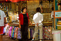 Two shoppers stand by a stall at the International Market Place in Waikiki.