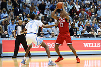 CHAPEL HILL, NC - FEBRUARY 25: C.J. Bryce #13 of North Carolina State University is guarded by Brandon Robinson #4 of the University of North Carolina during a game between NC State and North Carolina at Dean E. Smith Center on February 25, 2020 in Chapel Hill, North Carolina.