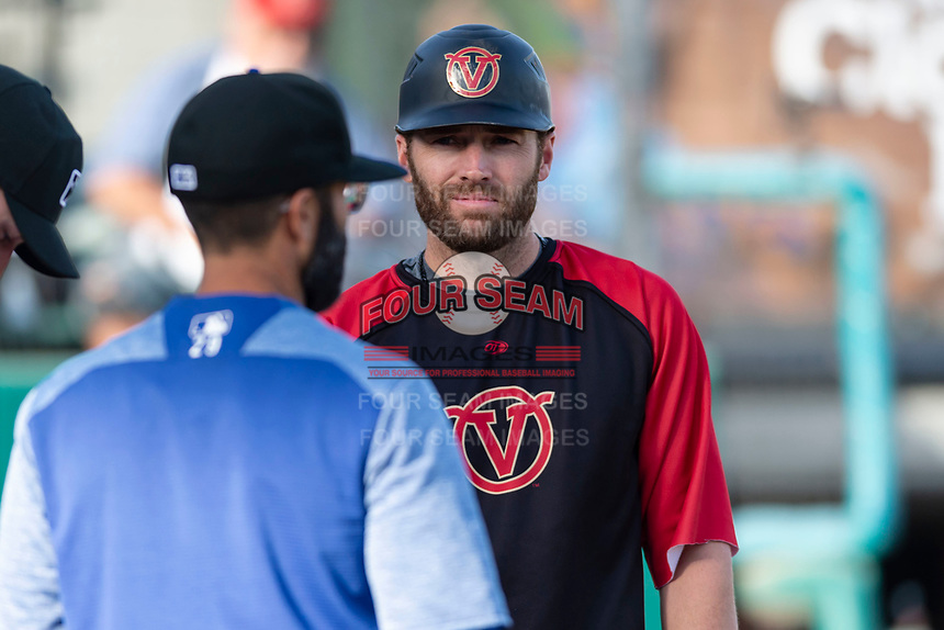 Visalia Rawhide coach Nick Evans meets with Quakes manager Mark Kertenian before a California League game against the Rancho Cucamonga Quakes on April 9, 2019 in Visalia, California. Visalia defeated Rancho Cucamonga 8-5. (Zachary Lucy/Four Seam Images)