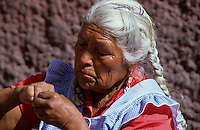 Portrait of a colorfull Tarahumara Indian in mexico cleaning her nails