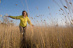 Monique Sady runs through the tall grass at the Ano Nuevo state park along Highway One on the Pacific Ocean near the coastal town of Pescadero, just north of Santa Cruz. Ano Nuevo is a prime mating ground for Elephant Seals in the winter.